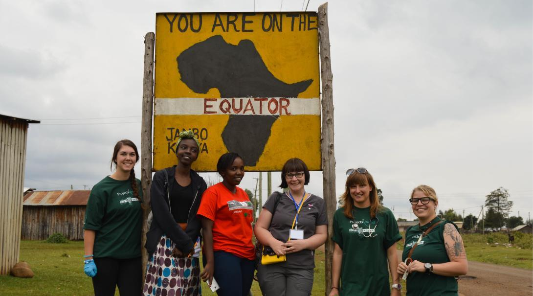 Medical elective interns abroad pose for a photo next to an 'Equator' sign in Nanyuki, Kenya